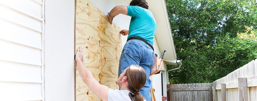 Family prepares for storm by boarding up house
